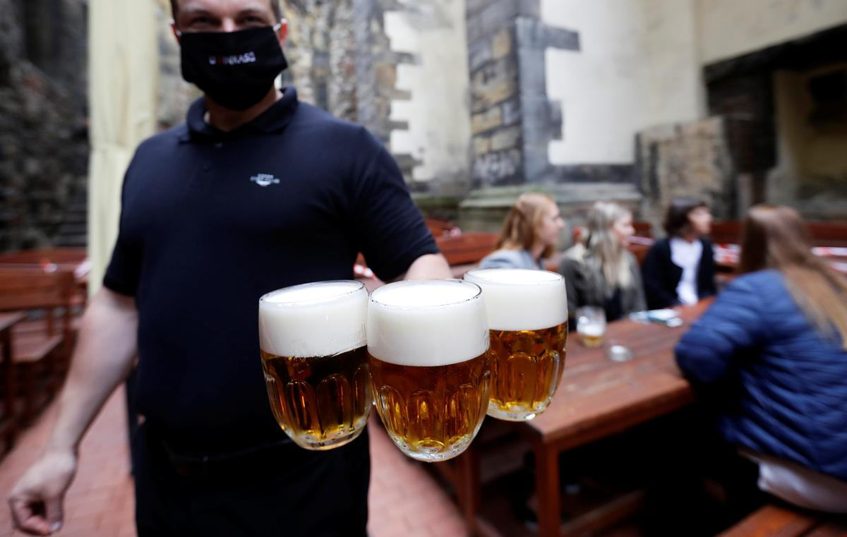 Thirsty Czechs toast return to beer gardens as lockdown eases