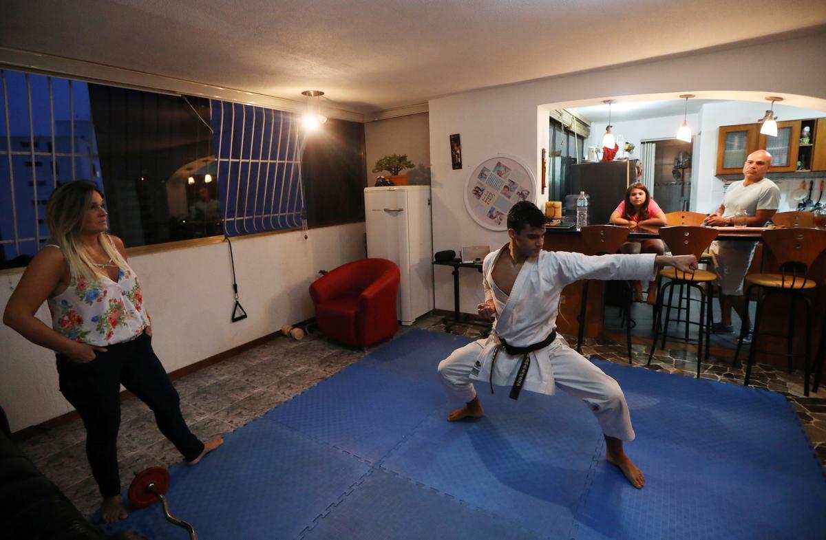 In quarantined Venezuela, karate champion takes training to living room
