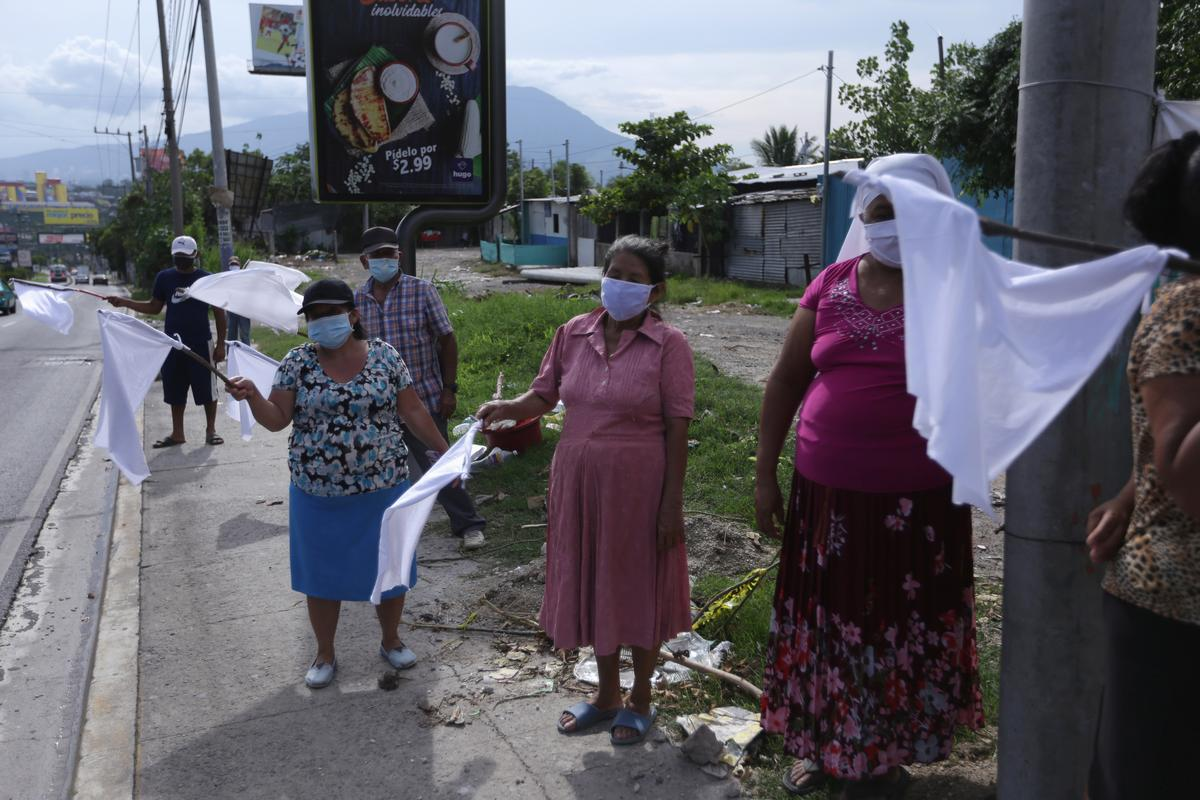 As hunger spreads under lockdown, Guatemalans and Salvadorans raise white flag