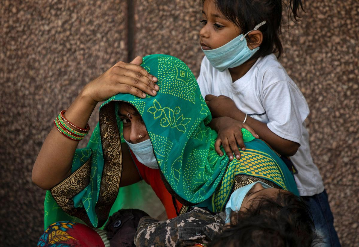 India reports biggest 24-hour rise in virus cases as lockdown eases
