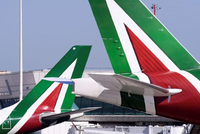 FILE PHOTO: Alitalia airplanes are pictured at Leonardo da Vinci-Fiumicino Airport in Rome, Italy, March 30, 2019. REUTERS/Alberto Lingria