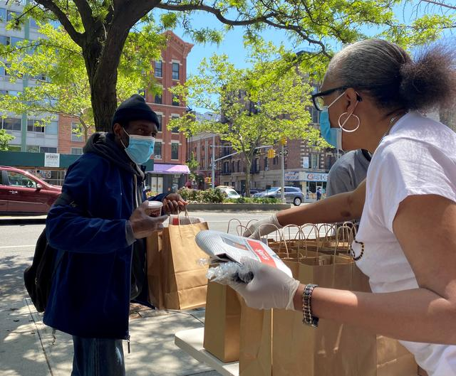 Volunteers at Salem United Methodist Church hand out grab-and-go meals from Rethink Food in New York, amid an outbreak of the coronavirus disease (COVID-19) in the U.S., May 21, 2020. REUTERS/Roselle Chen
