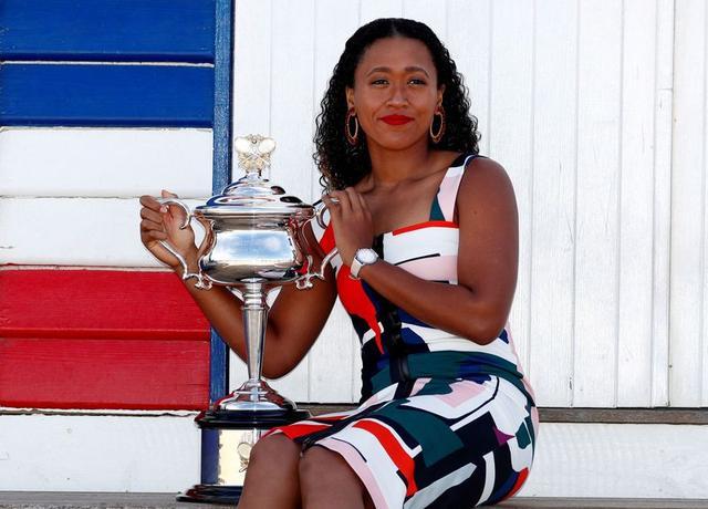 FILE PHOTO: Tennis - Australian Open - Women's Singles Photo Shoot - Brighton Beach, Melbourne, Australia, January 27, 2019. Japan's Naomi Osaka poses with her trophy. REUTERS/Edgar Su