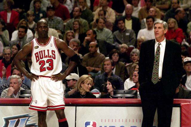 FILE PHOTO: June 7, 1998; Chicago, IL, USA; Chicago Bulls guard Michael Jordan and Utah Jazz coach Jerry Sloan assess their situations during a break in play during the 1998 NBA Finals. Mandatory Credit: Robert Hanashiro-USA TODAY