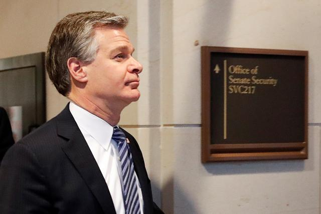 FILE PHOTO: FBI Director Christopher Wray departs following a national security briefing for members of the U.S. Senate about how Russia has been using social media to stoke racial and social differences ahead of this year's general election, on Capitol Hill in Washington, U.S., March 10, 2020. REUTERS/Carlos Barria/File Photo