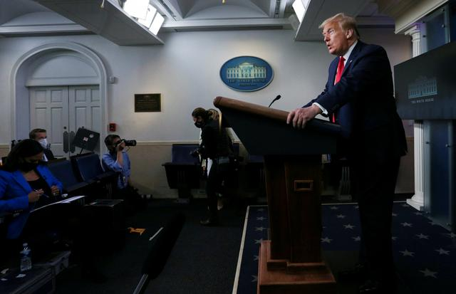 FILE PHOTO: U.S. President Donald Trump makes a statement to reporters about reopening U.S. places of worship by declaring them ''essential'' in the midst of the coronavirus disease (COVID-19) pandemic, in the Brady Press Briefing Room at the White House in Washington, U.S., May 22, 2020. REUTERS/Leah Millis