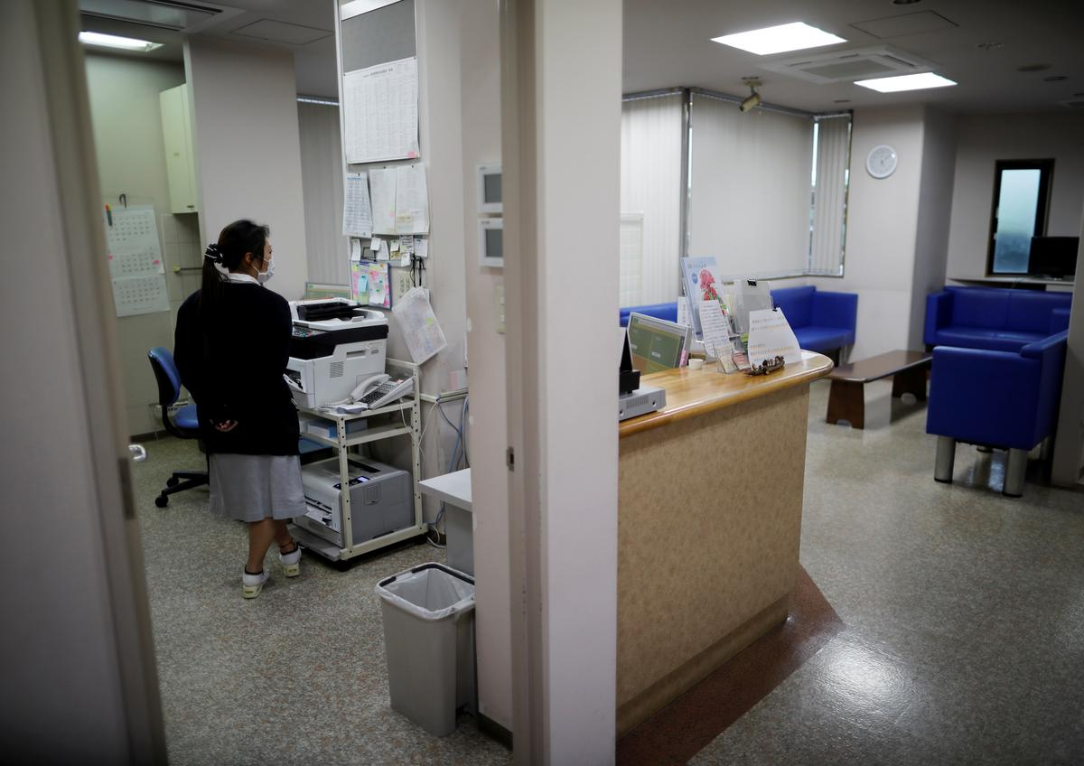 Japan's small clinics driven to brink as virus-wary patients stay home