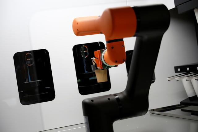 A robot that takes orders, makes coffee and brings the drinks straight to customers is seen in Daejeon, South Korea, May 25, 2020. REUTERS/Kim Hong-Ji