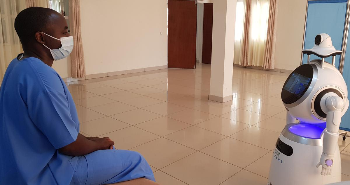 Rwandan medical workers deploy robots to minimize coronavirus risk