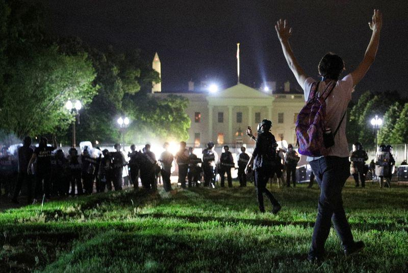 Trump says protesters would have met 'vicious dogs' if White House fence breached