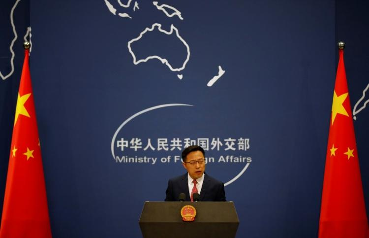 China rejects report that it delayed COVID-19 information sharing with WHO