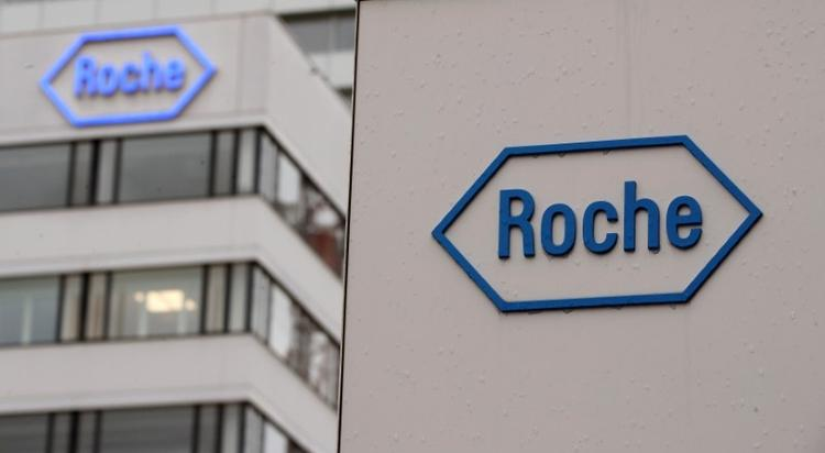 UPDATE 1-Roche test receives FDA emergency use approval for COVID-19 patients
