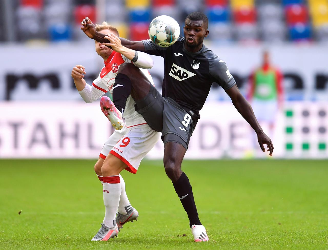 Hennings brace gives Duesseldorf 2-2 draw with 10-man Hoffenheim ...
