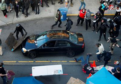 Man shot at Seattle protest after driver plows car into crowd
