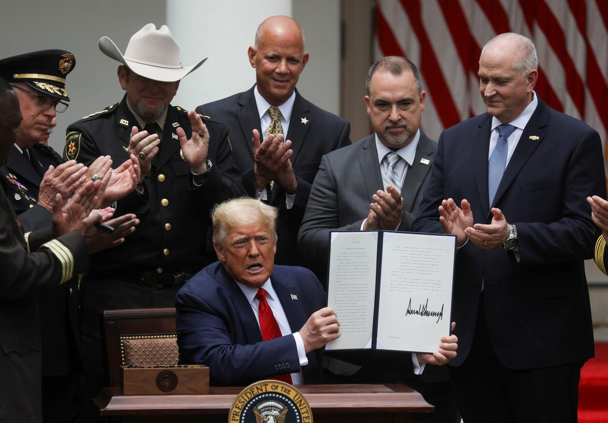 Trump signs order on police reform after weeks of protests about racial injustice