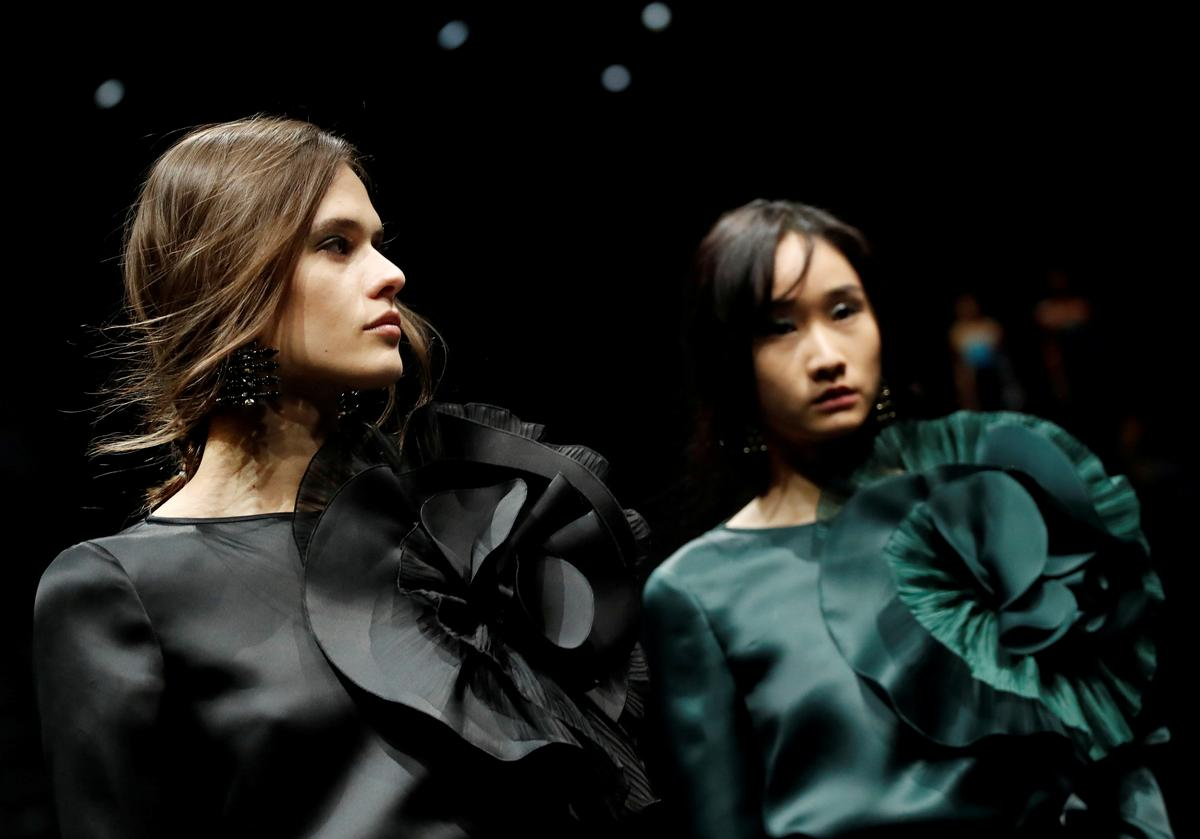 Designers fashion a go-slow future for catwalks and collections