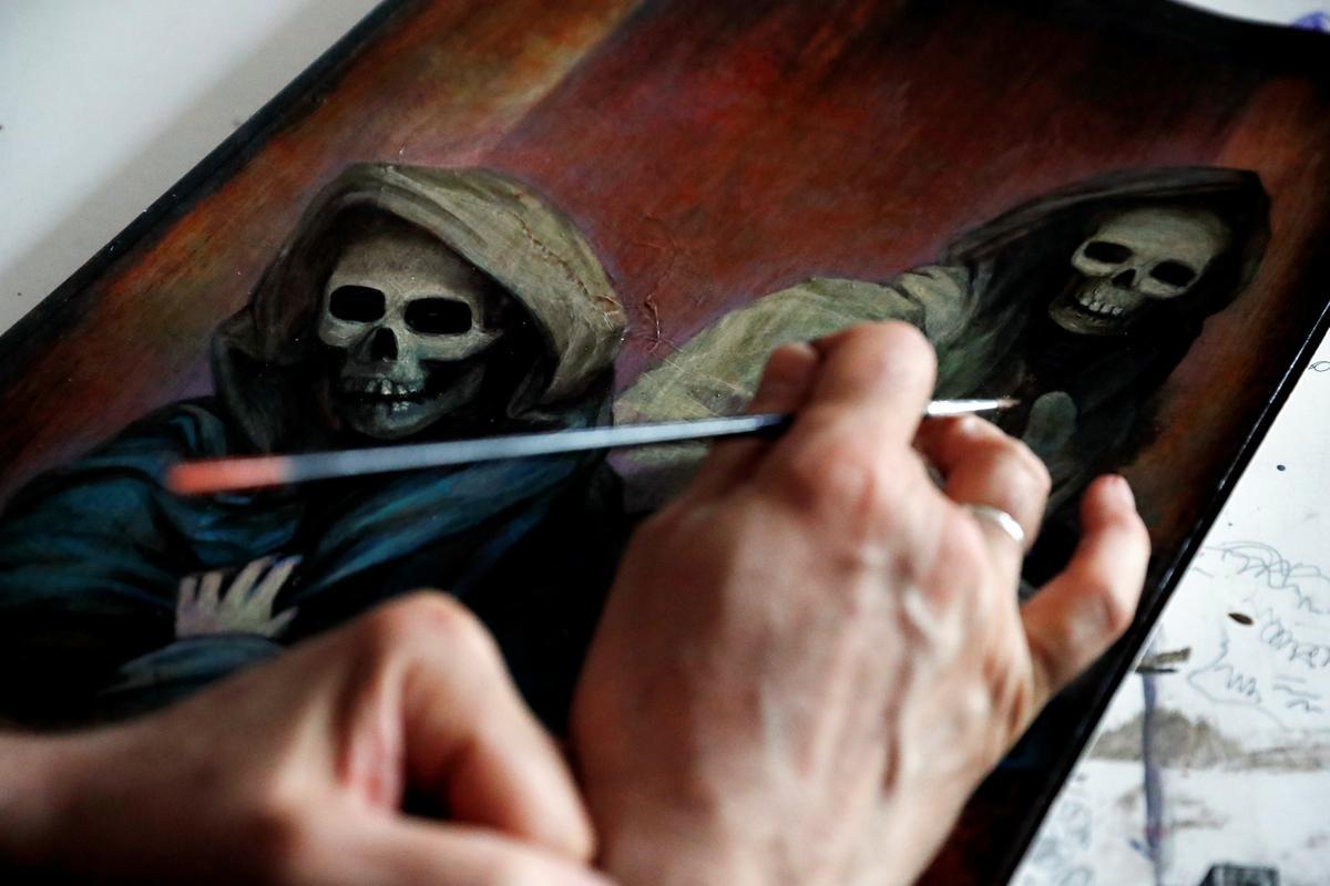 Grief over virus deaths sets Hungarian artist on darker course