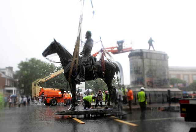 Crews stand around the statue of Confederate general Stonewall Jackson after it was removed from its pedestal in Richmond, Virginia, July 1, 2020. REUTERS/Julia Rendleman