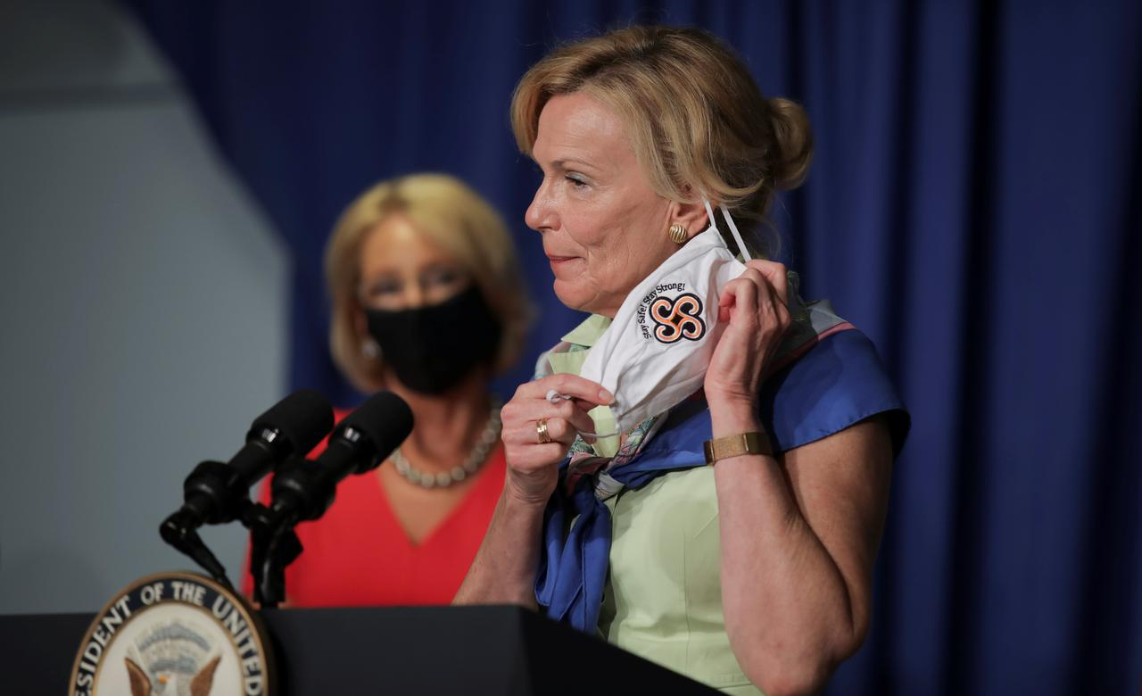 From scarves to masks: White House's Birx seeks to make coronavirus fashion  pivot - Reuters