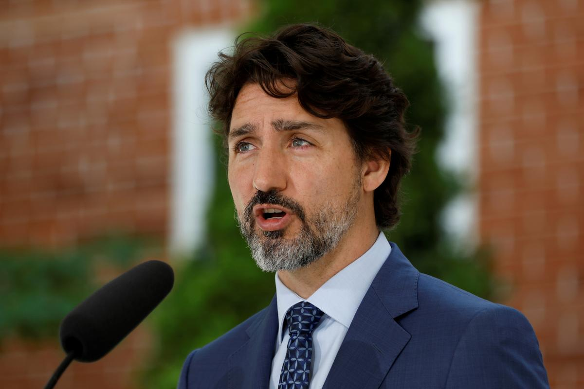 Pressure rises on Canada's Trudeau as parliamentary rivals seize on charity controversy