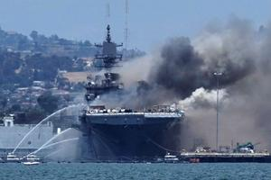 Fire crews battle San Diego navy ship fire