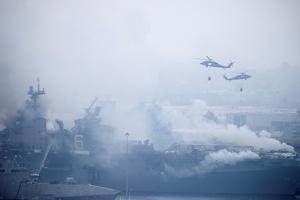 U.S. Navy battles to save burning warship in San Diego