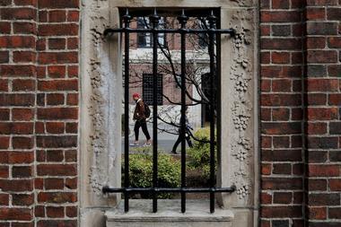 FILE PHOTO: Students and pedestrians walk through the Yard at Harvard...