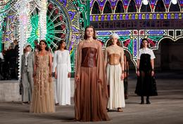 Dior showcases Italian folklore in catwalk show at dusk