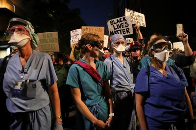 Healthcare workers join protests against racial inequality