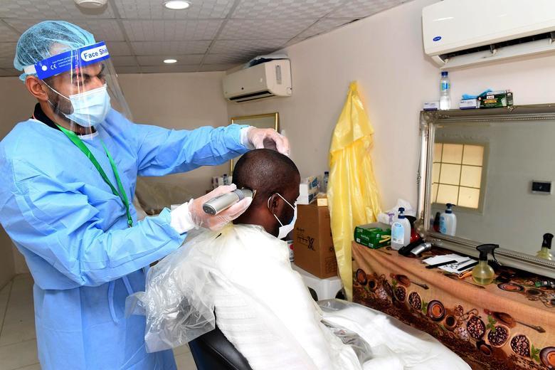 A Muslim pilgrim has his head shaved during the annual Haj pilgrimage in Mina, near the holy city of Mecca, Saudi Arabia July 31, <span dir=