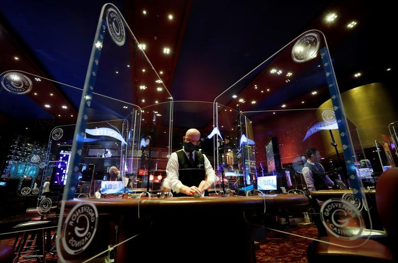 A staff member works before the reopening of Grosvenor Casino on St James' Blvd after lockdown due to the outbreak of the coronavirus in Newcastle upon Tyne, Britain July 31, 2020. REUTERS/Lee Smith