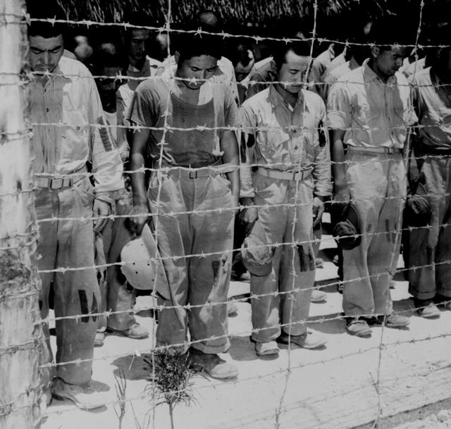 Japanese prisoners of war react with bowed heads after hearing Emperor Hirohito deliver the announcement of Japan\u0027s unconditional surrender, at a prison camp in Guam, August 15, 1945.  U.S. National Archives/via REUTERS
