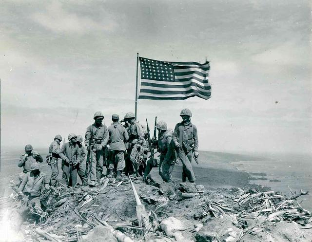 U.S. Marines raise the American flag atop Mount Suribachi on Iwo Jima, 1945.  U.S. National Archives/via REUTERS