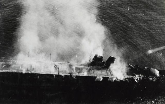The Japanese aircraft carrier Hiryu burns before sinking during the Battle of Midway June 5, 1942.    U.S. Navy/via REUTERS