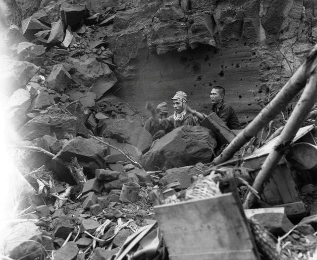 Three Japanese soldiers emerge from their hiding place to surrender during mopping-up operations by the U.S. Army on Iwo Jima, April 5, 1945.    U.S. National Archives/via REUTERS