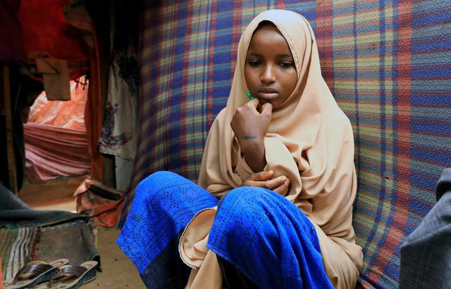 Nurta Mohamed, 13, a Somali girl sits inside her mother's makeshift shelter after she ran away from a suspected forced marriage at the Alafuuto camp for internally displaced persons in Garasbaaley district of Mogadishu, Somalia August 14, 2020. Picture taken August 14, 2020. REUTERS/Feisal Omar