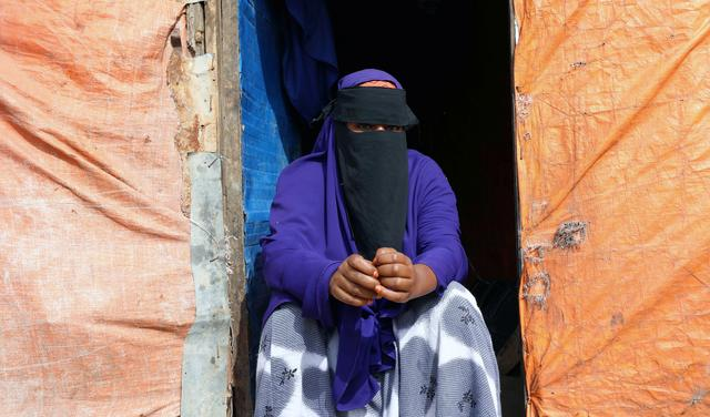 Hafsa Ali Osman, 15, a Somali girl suspected of being forced into marriage as a child sits outside her makeshift shelter at the Alafuuto camp for internally displaced persons in Garasbaaley district of Mogadishu, Somalia August 14, 2020. Picture taken August 14, 2020. REUTERS/Feisal Omar