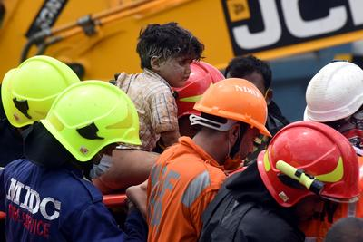 Survivors pulled from collapsed building in India