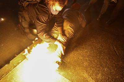 Portland protesters throw fire bombs at officers on 100th night of protests