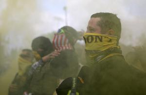Police clash with Portland anti-racism protesters after Proud Boys rally