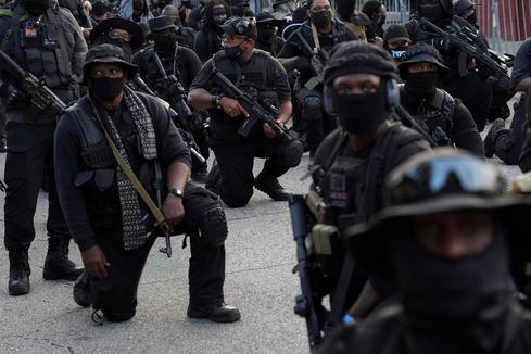 Black militia group NFAC marches in Lafayette