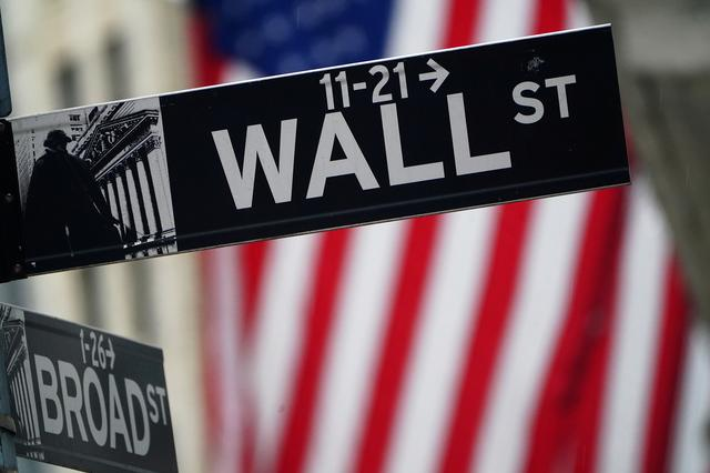 FILE PHOTO: A Wall Street sign is pictured outside the New York Stock Exchange in the Manhattan borough of New York City, New York, U.S., October 2, 2020. REUTERS/Carlo Allegri