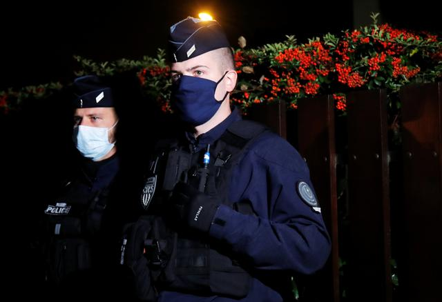 FILE PHOTO: Police officers secure the area near the scene of a stabbing attack in the Paris suburb of Conflans St Honorine, France, October 16, 2020. REUTERS/Charles Platiau