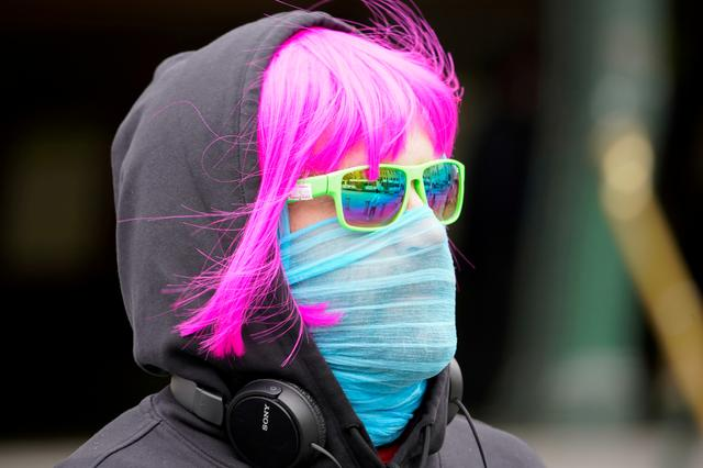 FILE PHOTO: A person wears a scarf as a protective face mask in Melbourne after it became the first city in Australia to enforce mask-wearing in public as part of efforts to curb a resurgence of the coronavirus disease (COVID-19), July 23, 2020. REUTERS/Sandra Sanders