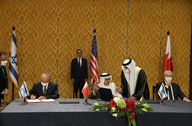 An Israeli delegation led by Israeli National Security Advisor Meir Ben Shabbat, signs an agreement with Bahraini officials in Manama, Bahrain October 18, 2020. REUTERS/Ronen Zvulun/Pool