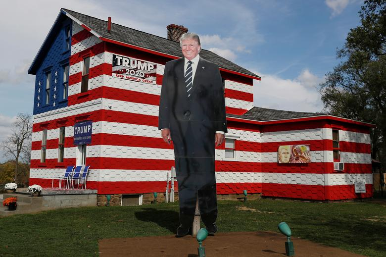 A 14-foot cut-out of President Trump stands on the front lawn of the self-proclaimed 'Trump House' in Youngstown, Pennsylvania. REUTERS/Shannon Stapleton