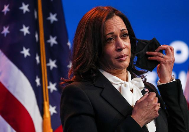 FILE PHOTO: U.S. Vice President-elect Kamala Harris listens as U.S. President-elect Joe Biden speaks to reporters following their online meeting with members of the National Governors Association (NGA) executive committee in Wilmington, Delaware, U.S., November 19, 2020. REUTERS/Tom Brenner