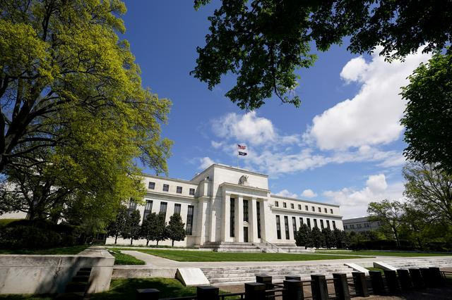FILE PHOTO: The Federal Reserve building is set against a blue sky, amid the coronavirus disease (COVID-19) outbreak, in Washington, U.S., May 1, 2020. REUTERS/Kevin Lamarque/File Photo