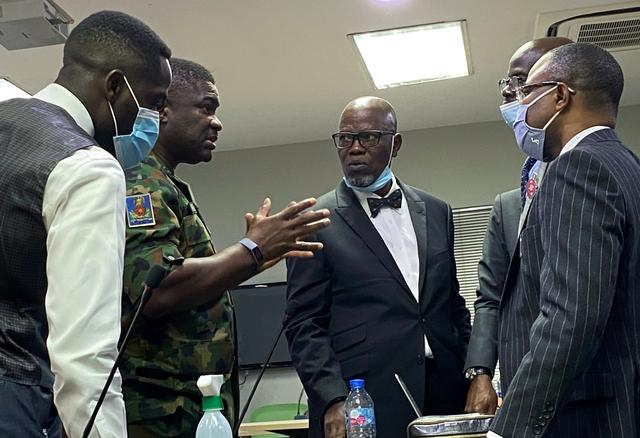 Brigadier General Ahmed Taiwo, who heads the army's 81st Division in Lagos, speaks with the counsel for the Nigerian Army, Akinlolu Kehinde and others, during a judicial panel investigating claims that Nigerian soldiers shot dead peaceful protesters in Lagos, Nigeria November 21, 2020. REUTERS/Seun Sanni