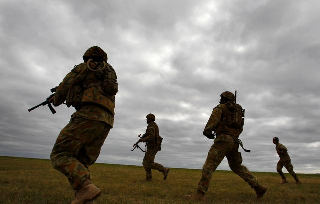 FILE PHOTO: Members of Australia's special forces conduct an exercise during the Australian International Airshow in Melbourne March 2, 2011. REUTERS/Mick Tsikas/